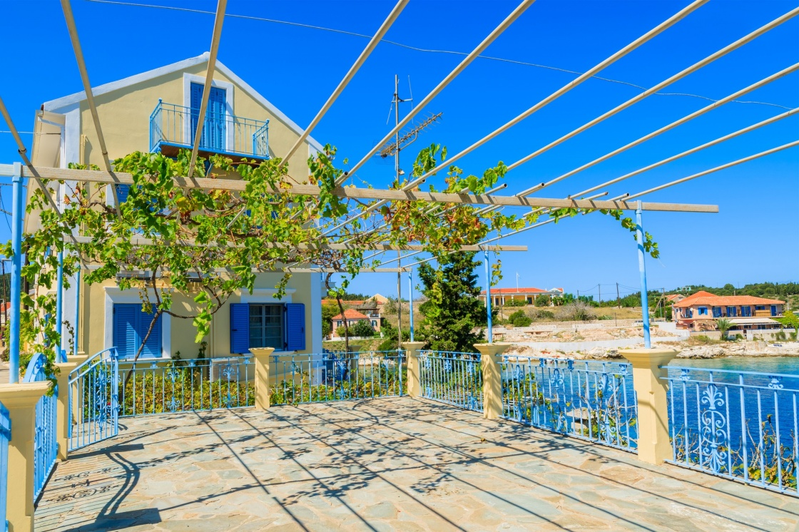 'Traditional greek house with vine growing on terrace in Fiskardo village, Kefalonia island, Greece' - Kefalonia