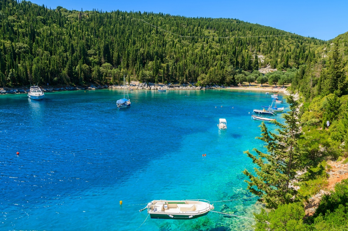 Fishing boats on turquoise sea in bay near Fiskardo village, Kefalonia island, Greece